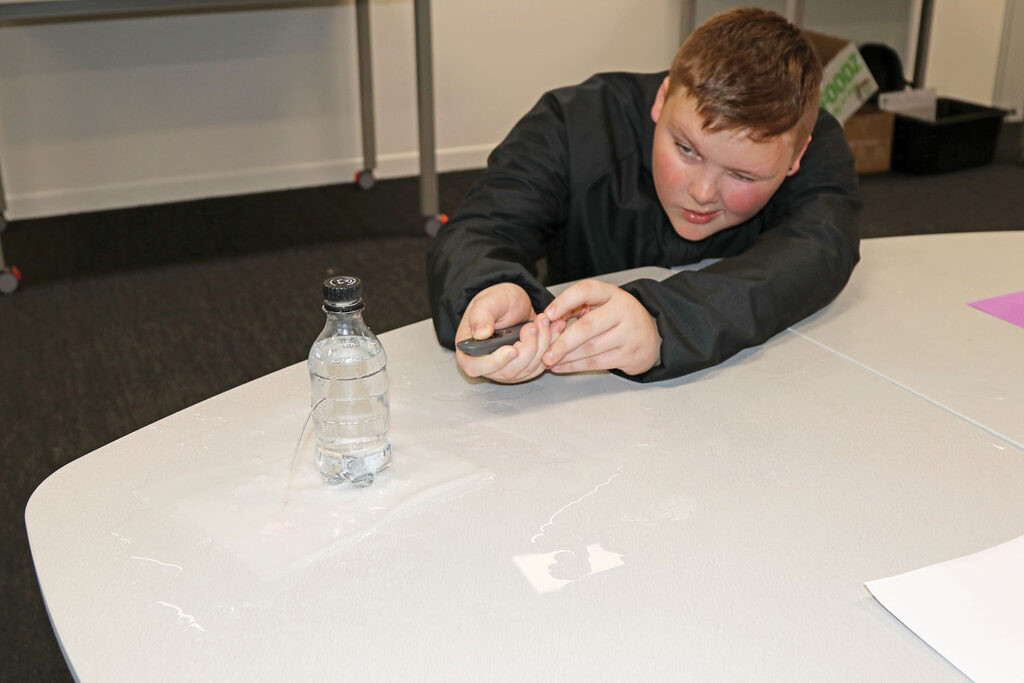 Conducting a laser and water experiment