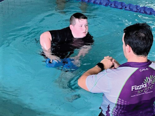 Dyllan taking part in hydrotherapy