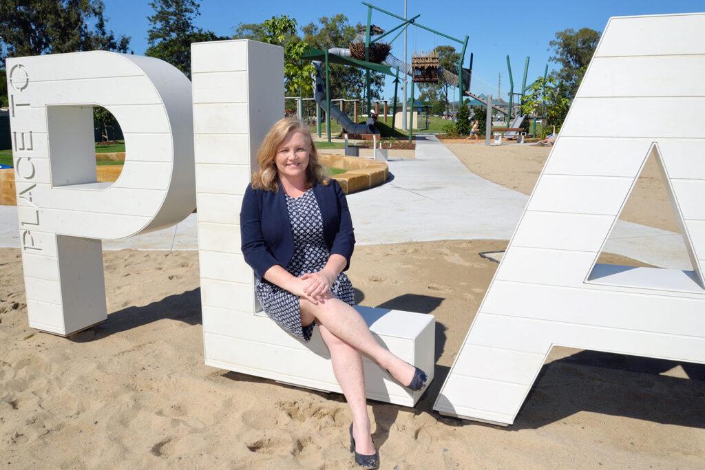 Cr Laurie Koranski and the new Logan Village Green Playground