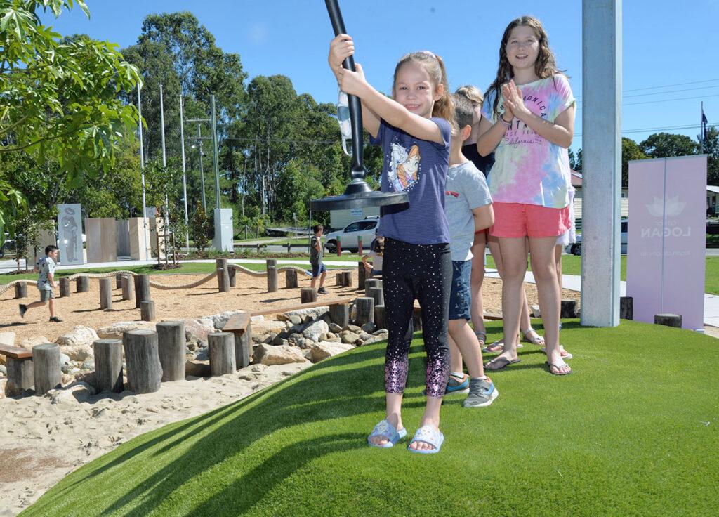 Children Enjoying New Village Green Playground