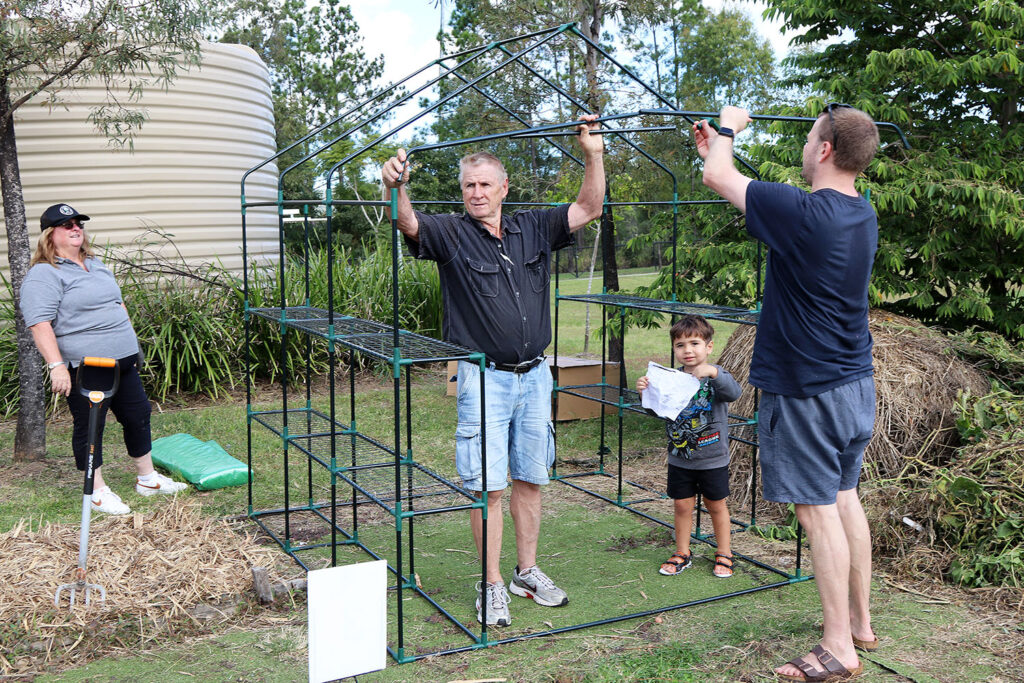 Building a greenhouse at the Gardens on Volunteers Day